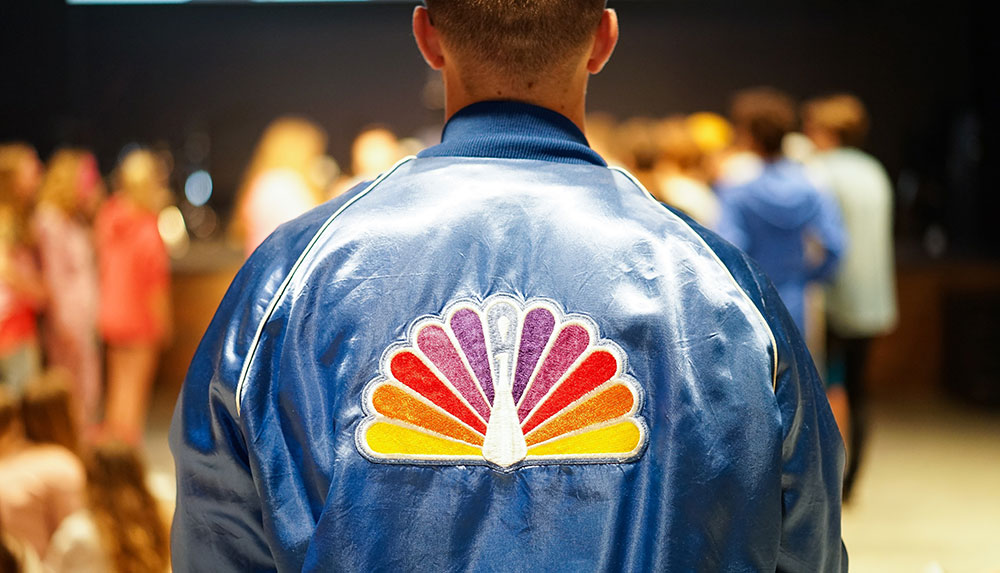 Pace University student in a NBC logo jacket