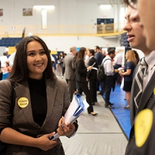 female pace university student at a career fair