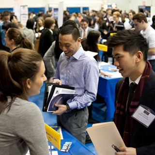 Students talking to employers at a job fair on campus