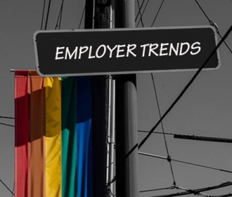 "LGBTQA flag and a street sign reading ""Employer Trends"""