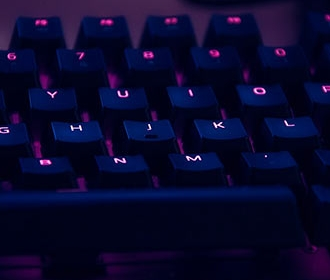 Keyboard lit up with blue and purple lighting
